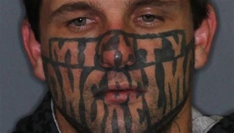 Gang member with 'Mighty Mongrel Mob' tattooed across his