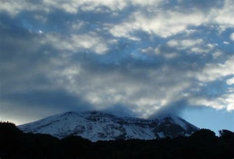Clouds erupt over Kibo, Kilimanjaro's summit crater (view