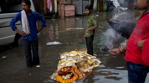 Ganges floods holy cremation site in India   CTV News